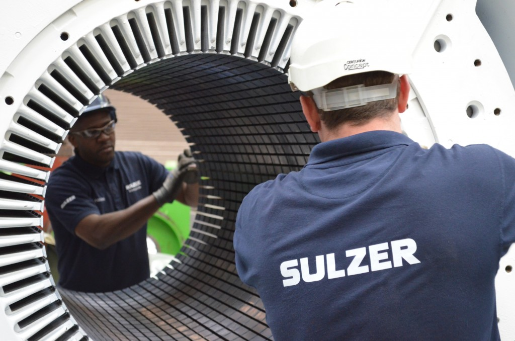 Sulzer employees working on a generator
